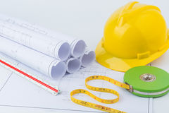 Yellow safety helmet and Green measuring tape Stock Photography