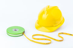 Yellow safety helmet and Green measuring tape Stock Image
