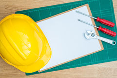 Yellow Safety Helmet Hat and clipboard Royalty Free Stock Photography
