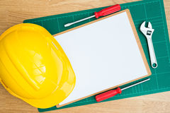 Yellow Safety Helmet Hat and clipboard Stock Photography
