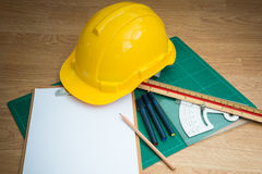 Yellow Safety Helmet Hat and clipboard Royalty Free Stock Photo