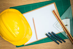 Yellow Safety Helmet Hat and clipboard Stock Images