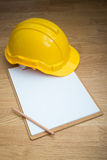 Yellow Safety Helmet Hat and clipboard Royalty Free Stock Image