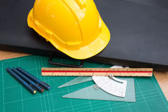 Yellow Safety Helmet Hat and Drawing Tools Stock Photo