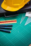 Yellow Safety Helmet Hat and Drawing Tools Royalty Free Stock Photos