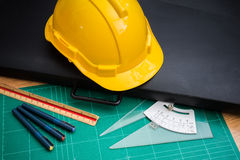 Yellow Safety Helmet Hat and Drawing Tools. Cutting pads, Drawing Paper Bags royalty free stock photography