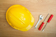 Yellow Safety Helmet Hat and tools Royalty Free Stock Photo