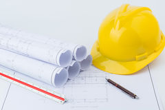Yellow safety helmet and plan drawing Stock Photography