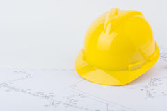 Yellow safety helmet and plan drawing Royalty Free Stock Image