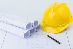Yellow safety helmet and plan drawing Stock Photos
