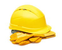 Yellow safety helmet and Protective gloves Stock Photos