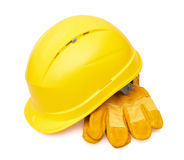 Yellow safety helmet and Protective gloves Royalty Free Stock Photo