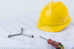 Yellow safety helmet and screwdriver Stock Images
