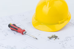 Yellow safety helmet and screwdriver Royalty Free Stock Image