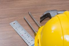 Yellow safety helmet and some tools. Top view of yellow safety helmet and some tools Royalty Free Stock Photography