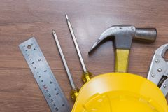 Yellow safety helmet and some tools. Top view of yellow safety helmet and some tools Stock Photo