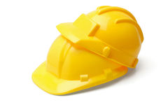 Yellow safety helmets. Piggyback yellow safety helmets on white background Stock Images