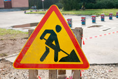 Yellow safety sign warns about roadworks. Under Construction sign Royalty Free Stock Images