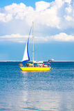 Yellow sailboat at sea Stock Photography