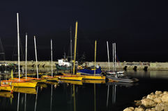 Yellow sailboats moored for the night Stock Photo