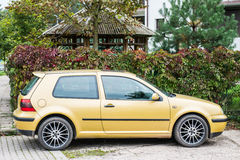 Yellow saloon car Stock Photos