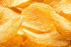 Yellow salted potato chips as background, closeup Stock Photography
