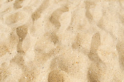 Yellow sand as background Stock Photos