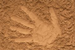 Yellow sand, pattern of palm, trace of hand, hand impression, im royalty free stock images