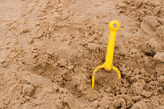 Yellow sand spade Stock Photos