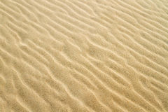 Yellow sand texture Stock Photos