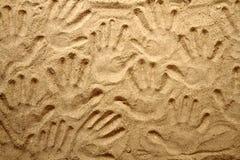Yellow sand texture (human hands) Stock Photos