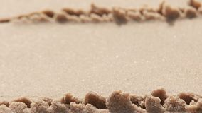 Yellow sand and water Stock Images