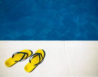 Yellow sandals  by the pool Stock Photo