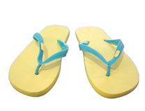 Yellow sandals on white Stock Photo