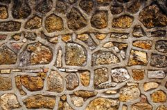 Yellow sandstone and thick cement wall, close up. Yellow sandstone and thick cement surface, macro royalty free stock photos