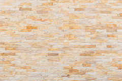 Yellow sandstone wall texture and background Royalty Free Stock Image