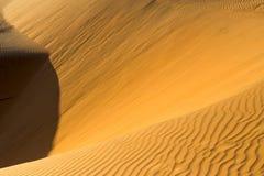 Yellow sandy wavy dunes in desert at daytime. Nobody. Nature landscape Stock Photos
