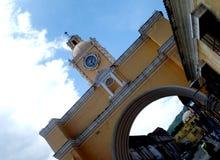 Yellow Santa Catalina arch in Antigua Guatemala. Shot of the Santa Catalina arch under a blue clouded sky in Antigua Guatemala Royalty Free Stock Image