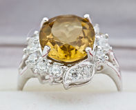 Yellow sapphire ring on white Stock Photo