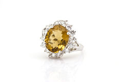 Yellow sapphire ring on white Stock Image