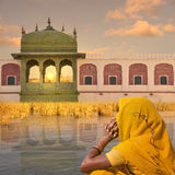 Yellow saree. Woman with yellow saree in front a hindu palace Royalty Free Stock Photo