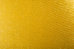 Yellow satin background. Close up studio shot Stock Photography
