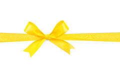 Yellow satin gift bow ribbon Stock Photos