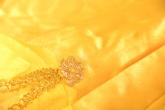 Yellow satin with pattern Royalty Free Stock Photos