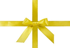 Yellow satin ribbon with bow stock image