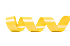 Yellow satin ribbon. On white background. studio shot Stock Photography