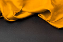 Yellow satin or silk background Stock Photography