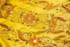 Yellow satin textile Stock Image
