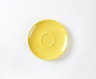Yellow saucer Royalty Free Stock Images