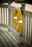 Yellow Saver. Yellow life saver tied to a bridge, Newfoundland stock image